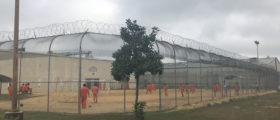 Detained immigrants play soccer behind a barbed wire fence at the Irwin County Detention Center in Ocilla, Georgia. February 20, 2018. Picture taken February 20, 2018. To match Special Report USA-IMMIGRATION/COURT. REUTERS/Reade Levinson