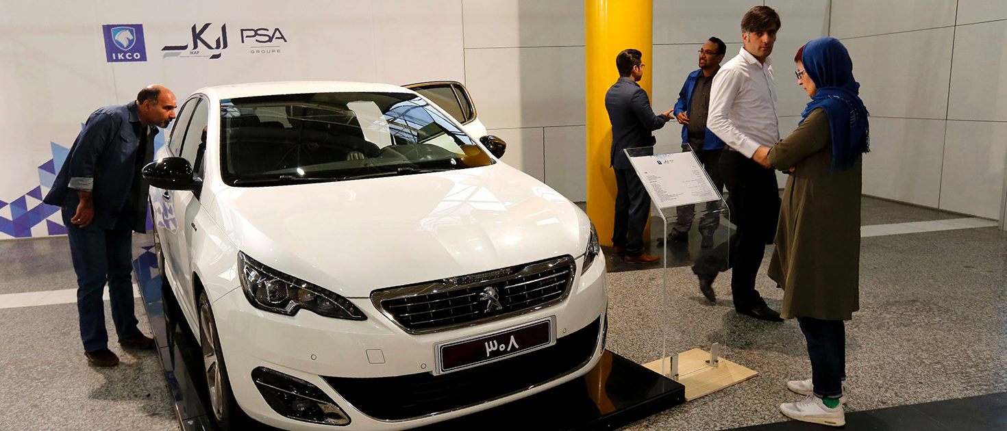 People inspect the new Peugeot 2008 car as they visit the Iran Khodro Industrial Group showroom in the Iranian capital Tehran, on October 5, 2016. ATTA KENARE/AFP/Getty Images