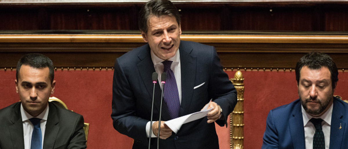 Giuseppe Conte, Italy's prime minister, center, delivers his maiden speech to the Senate, as Luigi Di Maio, Italy's deputy prime minister, left, and Matteo Salvini, Italy's deputy prime minister, right, look on in Rome, Italy, on Tuesday, June 5, 2018. Civil law professor Conte, 53, was vaulted from faculty battles at Florence University to the head of a potentially fractious coalition whenLuigi Di Maioof the Five Star Movement and League LeaderMatteo Salvinineeded an outsider to reconcile their different priorities. Photographer: Alessia Pierdomenico/Bloomberg via Getty Images