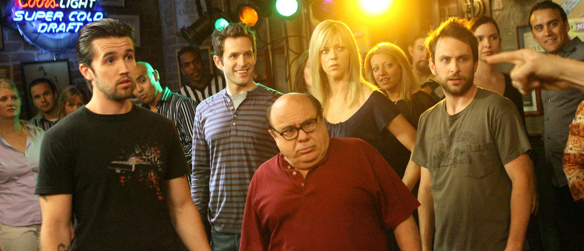 "LOS ANGELES, CA - MAY 23: (L-R) Actors Rob McElhenney, Glenn Howerton, Kaitlin Olson, Danny DeVito and Charlie Day act during a dance scene on the set of ""It's Always Sunny In Philadelphia"" on May 23, 2007 in Los Angeles, California. (Photo by Michael Buckner/Getty Images)"