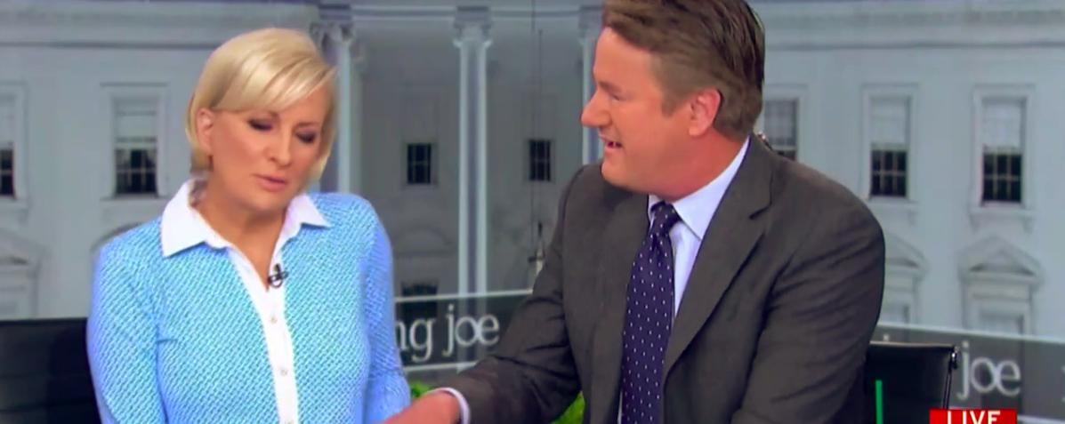 Joe Scarborough attempts to hold Mika Brzezinski's hand on air Thursday, June 21, 2018. (Photo: Screenshot/MSNBC)