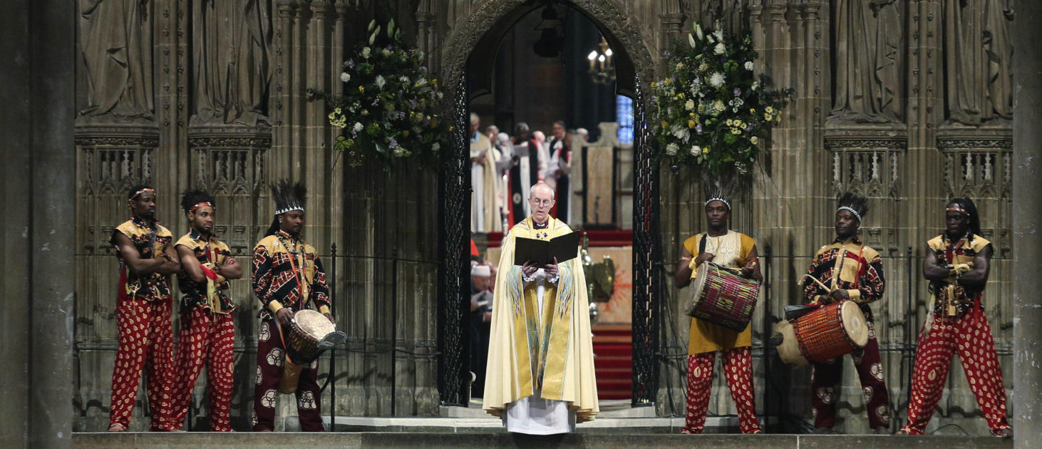 The new Archbishop of Canterbury, Justin Welby, attends his enthronement ceremony at Canterbury Cathedral in Canterbury, southern England March 21, 2013. The new spiritual leader of the world's Anglicans was enthroned by a female cleric on Thursday, taking the helm at a time when the troubled church risks tearing itself apart over gay marriage and women bishops. REUTERS/Philip Toscano/Pool