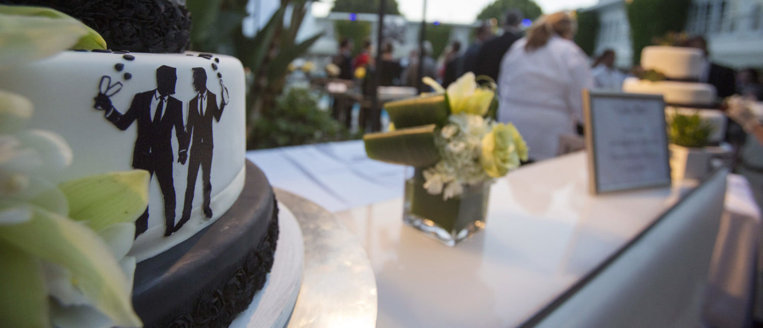Groom figurines are seen on a cake at a ceremony to celebrate the wedding of Jeff Zarrillo and Paul Katami at Beverly Hilton Hotel in Beverly Hills, California June 28, 2014. A year after becoming among the first same-sex couples to wed legally in California, the two men who were plaintiffs in the case that led to a court overturning the state's five-year ban on gay marriage held a lavish ceremony on Saturday with family and friends including Hollywood stars to celebrate their wedding. REUTERS/Mario Anzuoni (UNITED STATES - Tags: SOCIETY ENTERTAINMENT POLITICS) - GM1EA6T19H001