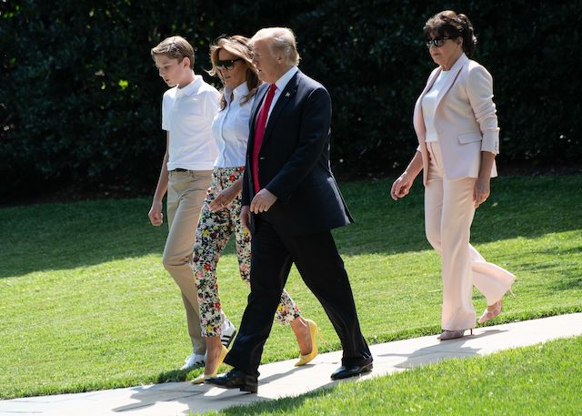 US President Donald Trump (2nd L), First Lady Melania Trump (2nd R), their son Barron and Melania Trump's mother Amalija Knavs walk to board Marine One at the White House in Washington, DC, on June 29, 2018 as they depart for Bedminster, New Jersey. (Photo credit: NICHOLAS KAMM/AFP/Getty Images)