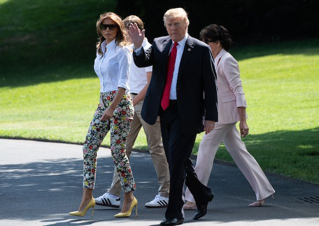 US President Donald Trump (2nd R), First Lady Melania Trump (L), their son Barron (2nd L) and Melania Trump's mother Amalija Knavs (R) walk to board Marine One at the White House in Washington, DC, on June 29, 2018 as they depart for Bedminster, New Jersey. (Photo credit: NICHOLAS KAMM/AFP/Getty Images)