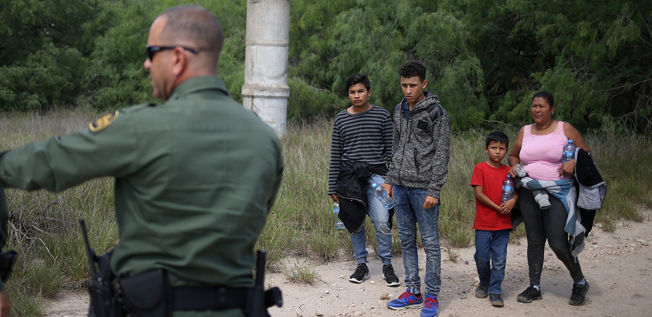 People who illegally crossed the Mexico-U.S. border turn themselves in to U.S. Border Patrol agents near McAllen, Texas, U.S., May 9, 2018. REUTERS/Loren Elliott