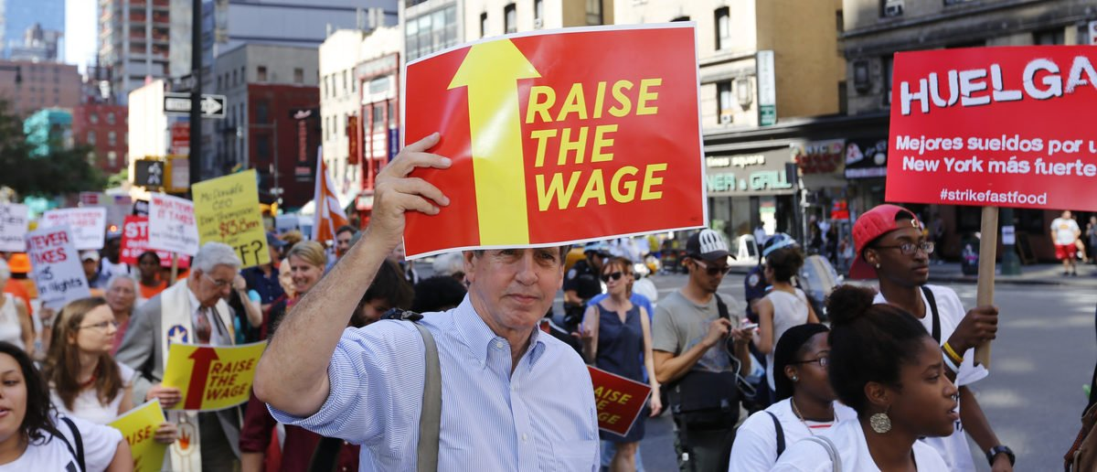 NEW YORK CITY - SEPTEMBER 4 2014: fast food workers and their supporters marched along 8th Ave calling for an increase in the minimum wage. Some attempted to block the street leading to several arrests. (Shutterstock/a katz)