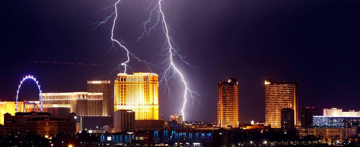 Lightning strikes behind Las Vegas Strip casinos as a thunderstorm passes through Las Vegas, Nevada, U.S. September 13, 2017. REUTERS/Steve Marcus