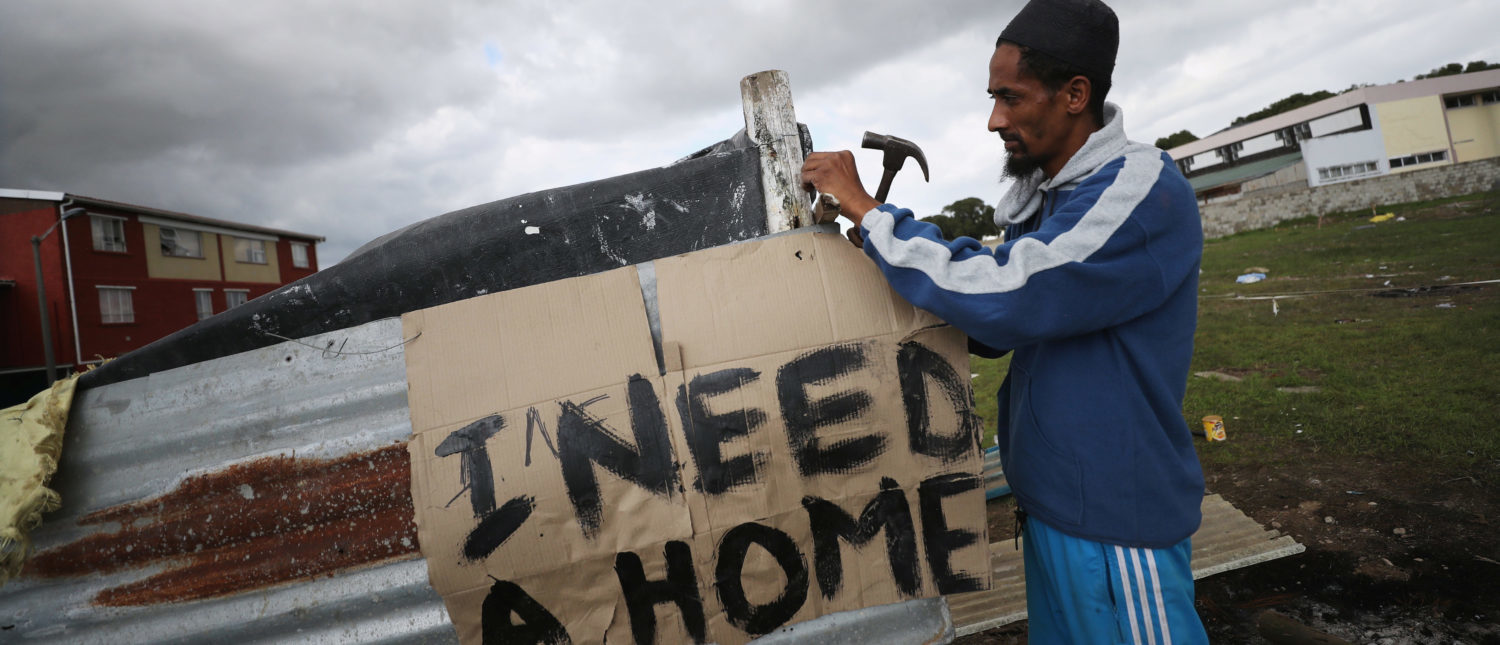Father of seven, Muneer Baxter, works on a shack erected during illegal land occupations, in Mitchell's Plain township near Cape Town, South Africa, May 29, 2018. Picture taken May 29, 2018. REUTERS/Mike