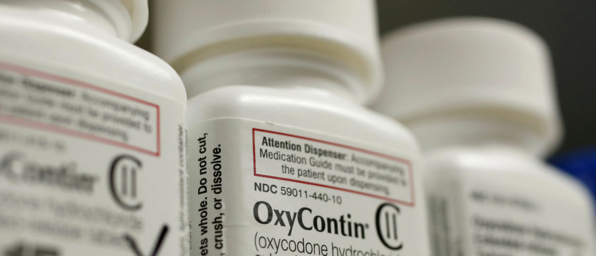 Bottles of prescription painkiller OxyContin made by Purdue Pharma LP sit on a shelf at a local pharmacy in Provo, Utah, U.S., April 25, 2017. REUTERS/George Frey/File Photo
