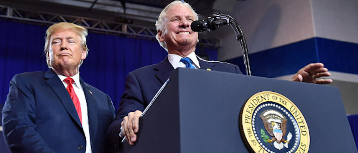 South Carolina Governor Henry McMaster (R), flanked by US President Donald Trump, speaks at a rally at Airport High School in West Columbia, South Carolina, on June 25, 2018. (Photo credit: MANDEL NGAN/AFP/Getty Images)
