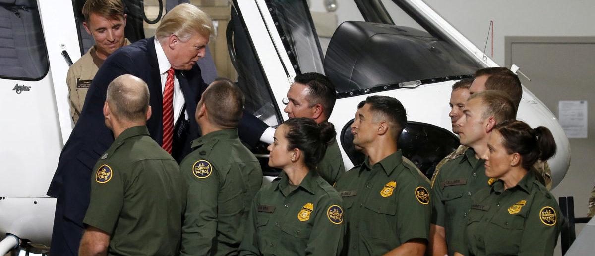 U.S. President Donald Trump greets Border Patrol agents as he tours the U.S. Customs and Border Patrol facility in Yuma, Arizona, U.S., August 22, 2017. REUTERS/Joshua Roberts