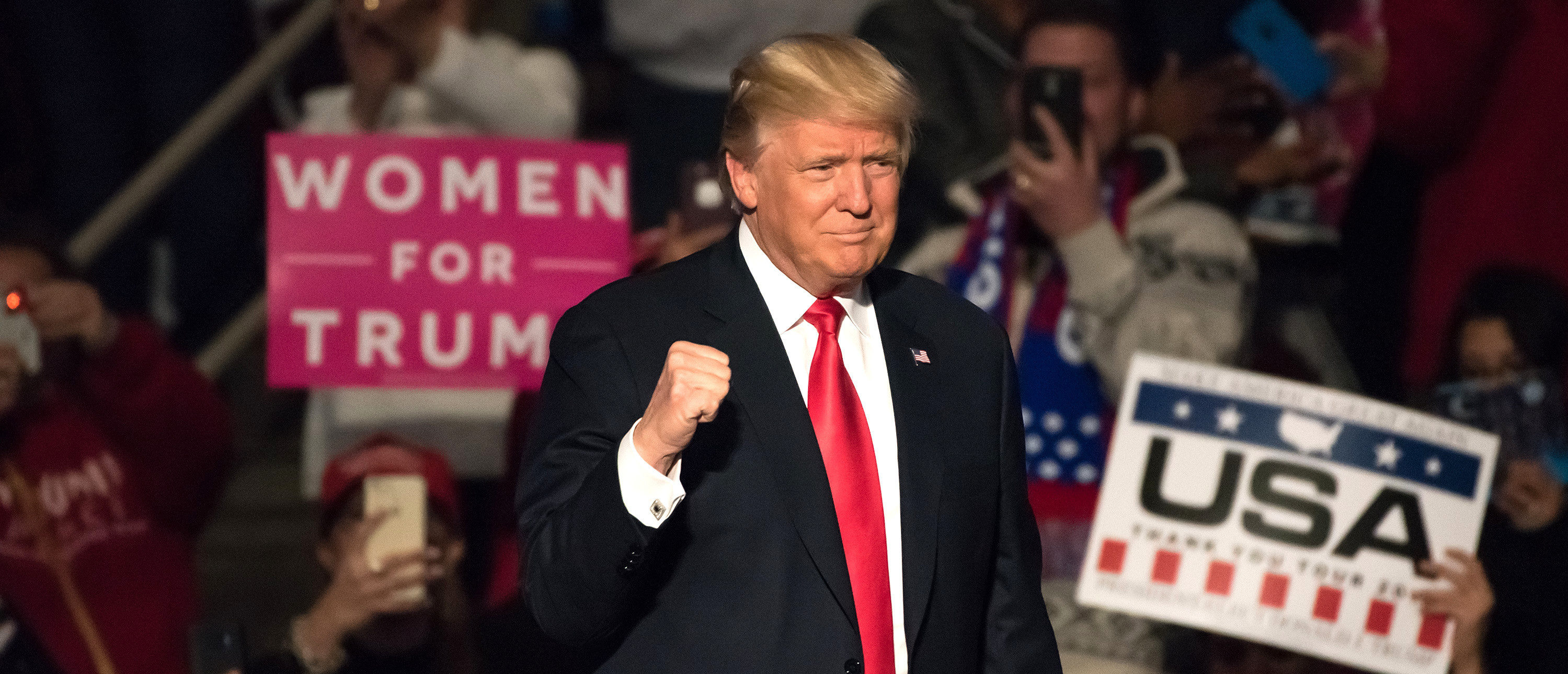 """HERSHEY, PA - DECEMBER 15, 2016: President-Elect Donald Trump gives a """"Fist Pump"""" as the confidently arrives on stage to deliver a speech at the """"Thank You"""" Tour rally at the Giant Center. Evan El-Amin/Shutterstock"""