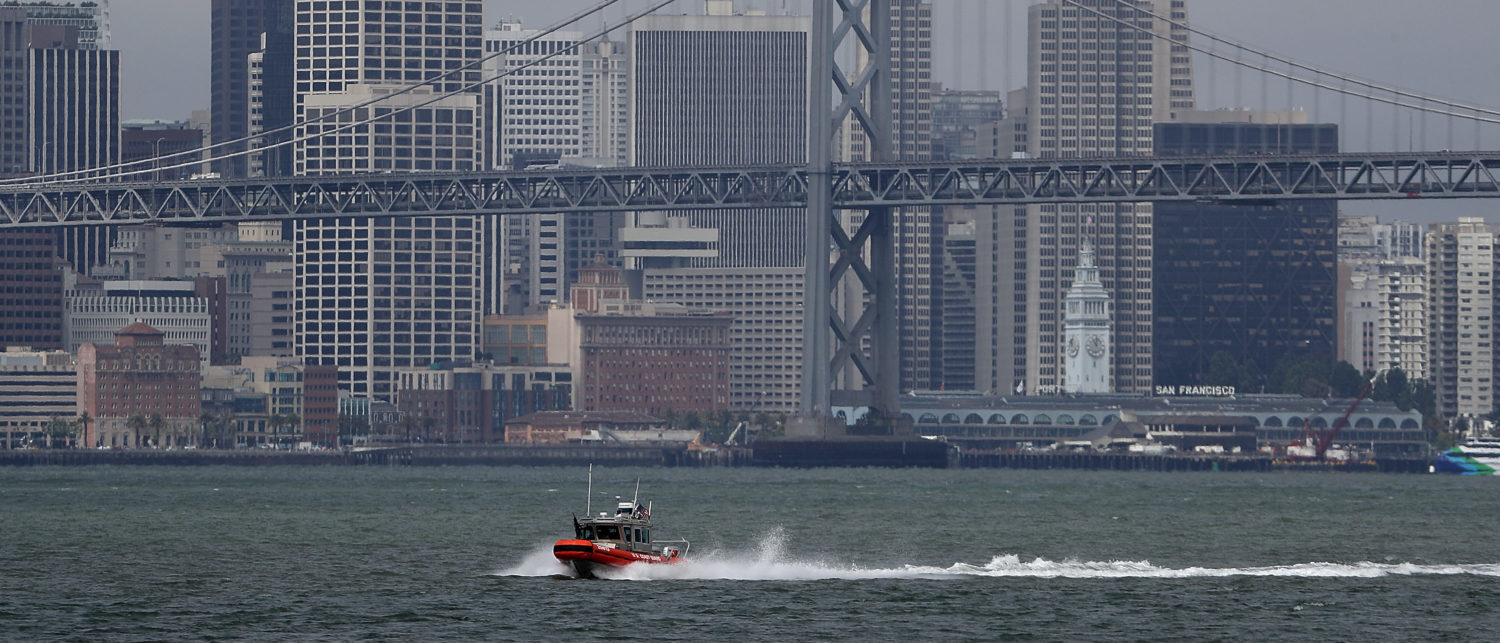 OAKLAND, CA - JUNE 20: A U.S. Coast Guard boat passes in front of the San Francisco Skyline on June 20, 2018 in Oakland, California. The Trump administration is considering a plan to move money from the U.S. Coast Guard to other parts of the Department of Homeland Security as immigration enforcement on the Southern border increases. (Photo by Justin Sullivan/Getty Images)