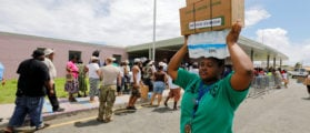 A resident stacks the water and food she received at an aid distribution center on her head in the aftermath of Hurricane Maria in Frederiksted, St. Croix, U.S. Virgin Islands September 29, 2017. REUTERS/Jonathan Drake