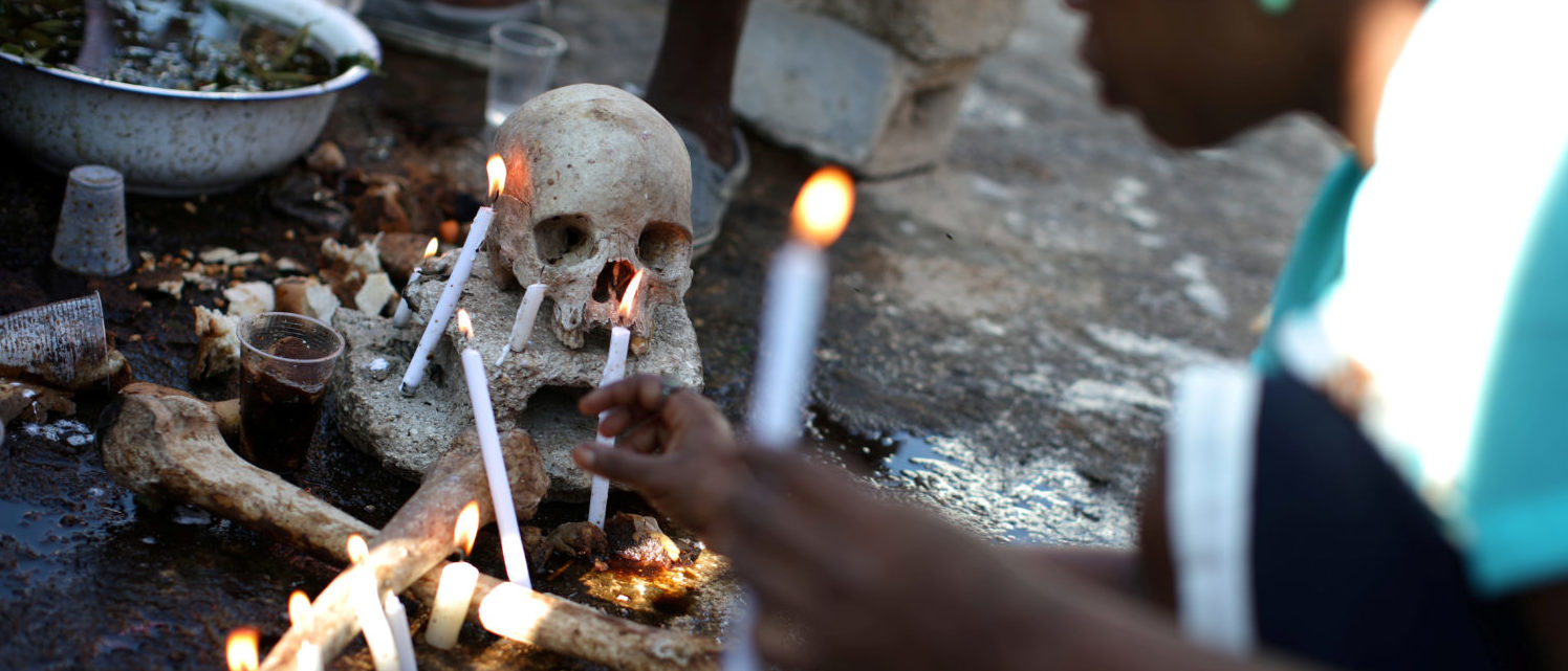 A voodoo believer makes offerings during celebrations at the cemetery of Port-au-Prince, Haiti, November 1, 2017. REUTERS/Andres Martinez Casares