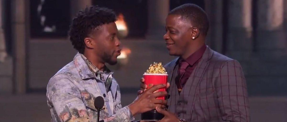 "Chadwick Boseman passes on his MTV ""Best Hero Award"" to Waffle House hero James Shaw Jr. on June 18, 2018. (Twitter screenshot)"