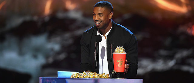 SANTA MONICA, CA - JUNE 16: Actor Michael B. Jordan accepts the Best Villain award for 'Black Panther' onstage during the 2018 MTV Movie And TV Awards at Barker Hangar on June 16, 2018 in Santa Monica, California. (Photo by Kevin Winter/Getty Images for MTV)