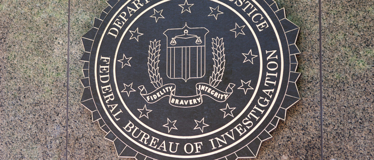 FBI seal located outside the J. Edgar Hoover F.B.I. Building in downtown Washington, DC on June 1, 2014. Shutterstock/Mark Van Scyoc