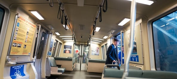 A man in a business suit exits a Bay Area Rapid Transit (BART) light rail train at San Francisco International Airport, San Francisco, California, September 13, 2017. (Photo via Smith Collection/Gado/Getty Images).
