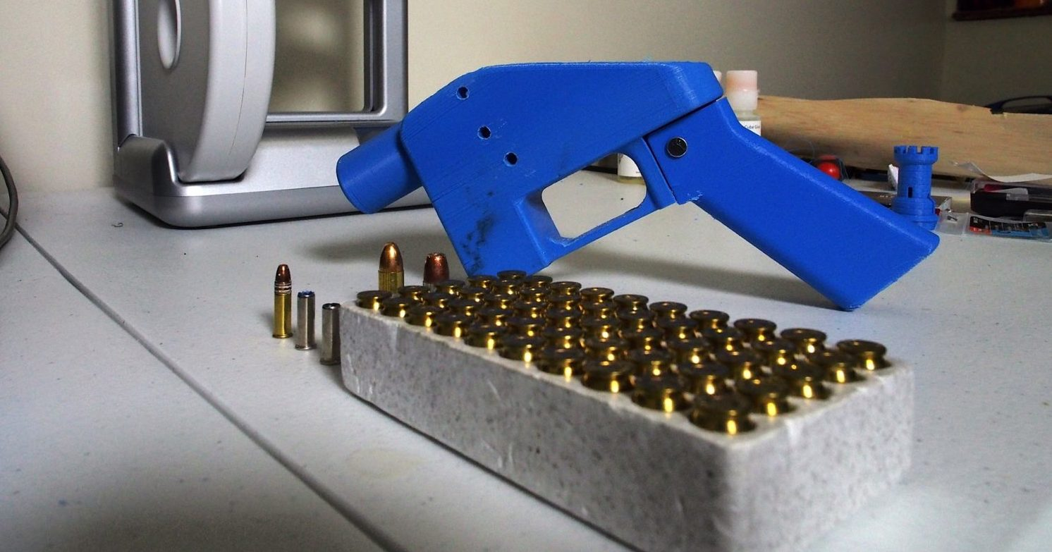 A Liberator pistol appears on July 11, 2013 next to the 3D printer on which its components were made. The single-shot handgun is the first firearm that can be made entirely with plastic components forged with a 3D printer and computer-aided design (CAD) files downloaded from the Internet. (Robert MacPherson/AFP/Getty Images)