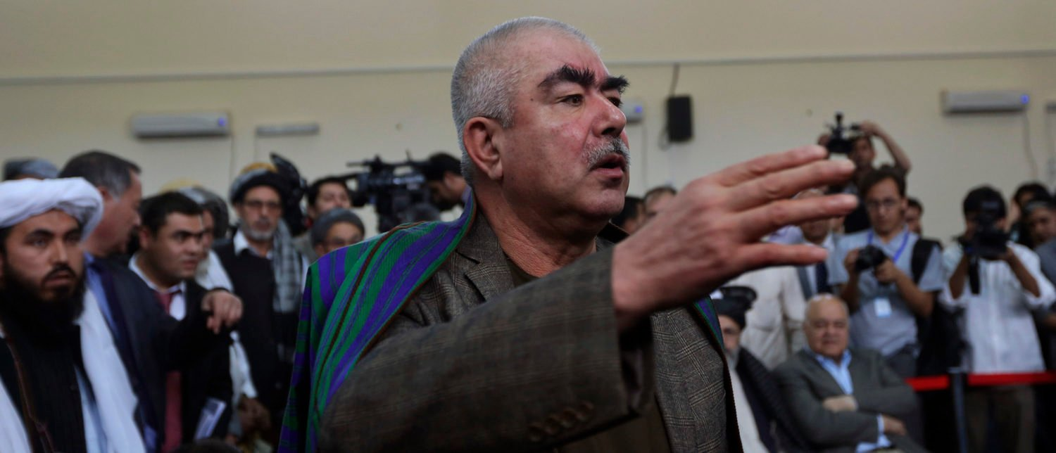 Abdul Rashid Dostum, an Uzbek leader and a vice-presidential candidate, talks with his supporters at the Afghanistan's Independent Election Commission (IEC) in Kabul October 6, 2013. Three men considered as front runners in Afghanistan's presidential election staged dramatic last-minute nominations on Sunday, the start of what is expected to be a chaotic but critical race for the palace in the first democratic transfer of power. REUTERS/Omar Sobhani