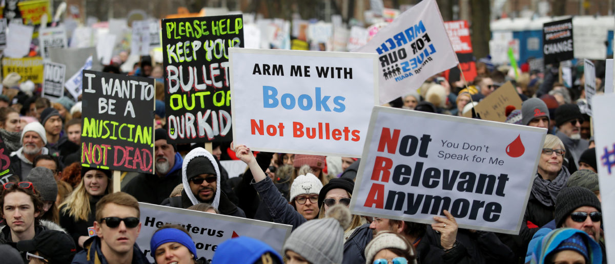 """Students and gun control advocates attend the """"March for Our Lives"""" event after recent school shootings, at a rally in in Chicago, Illinois, U.S., March 24, 2018. REUTERS/Joshua Lott"""