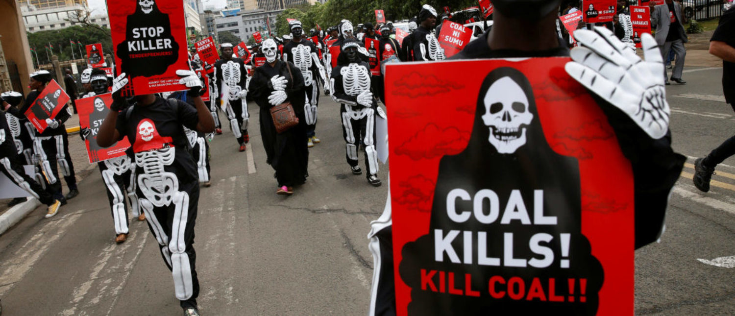 Environmental activists wearing costumes carry placards as they protest against a planned coal plant during the World Environment Day in Nairobi, Kenya, June 5, 2018. REUTERS/Baz Ratner