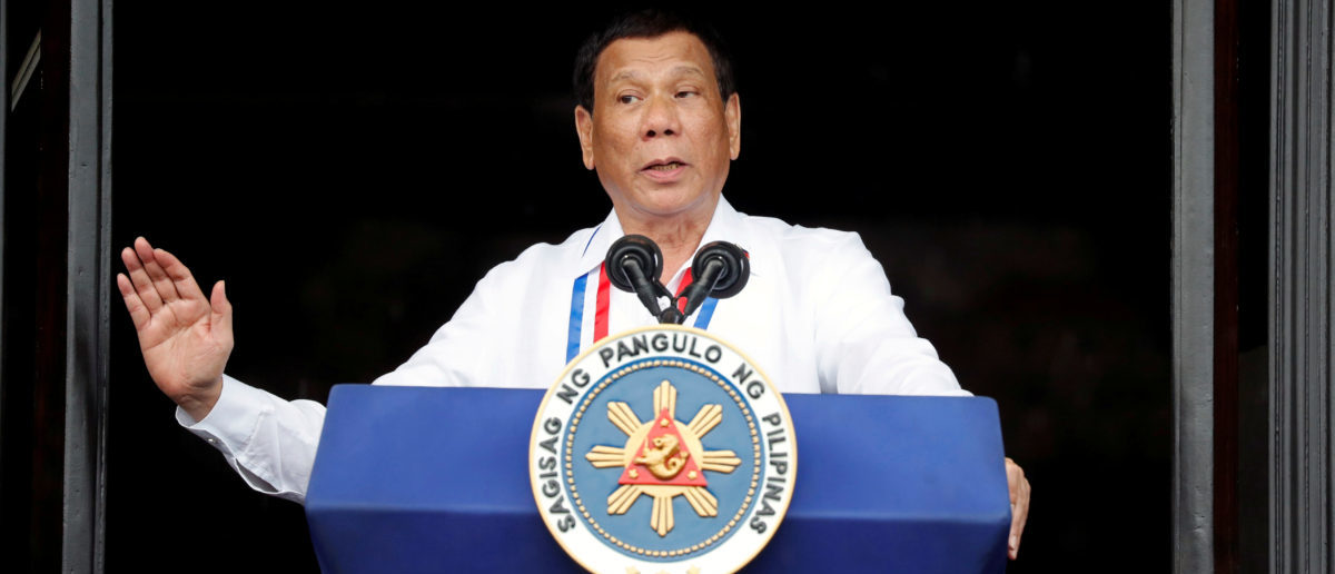 FILE PHOTO: Philippine's President Rodrigo Duterte speaks during the 120th Philippine Independence day celebration at the Emilio Aguinaldo shrine in Kawit, Cavite Philippines June 12, 2018. REUTERS/Erik De Castro/File Photo