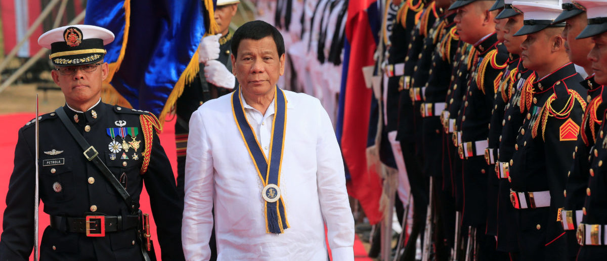 Philippine President Rodrigo Duterte reviews honour guards upon his arrival during the Philippine Navy's 120th anniversary in Metro Manila, Philippines May 22, 2018. REUTERS/Romeo Ranoco
