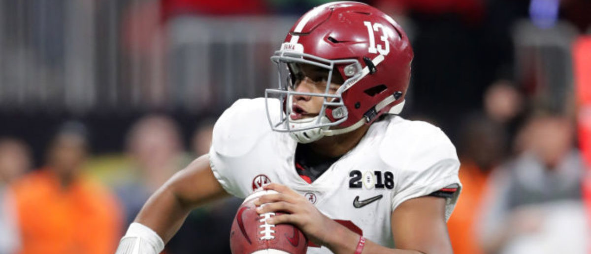 ATLANTA, GA - JANUARY 08: Tua Tagovailoa #13 of the Alabama Crimson Tide rolls out on a pass play during the second half against the Georgia Bulldogs in the CFP National Championship presented by AT&T at Mercedes-Benz Stadium on January 8, 2018 in Atlanta, Georgia. (Photo by Streeter Lecka/Getty Images)