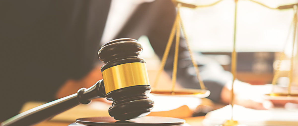 A gavel and scales of justice sit on a desk. (Shutterstock/MIND AND I)