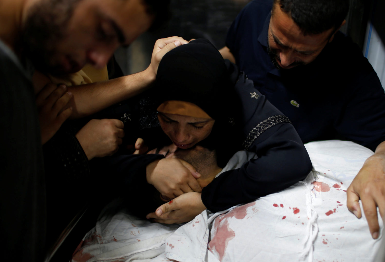 The mother of a Palestinian, who was killed at the Israel-Gaza border during a protest, reacts over his body in Gaza city July 6, 2018. REUTERS/Mohammed Salem