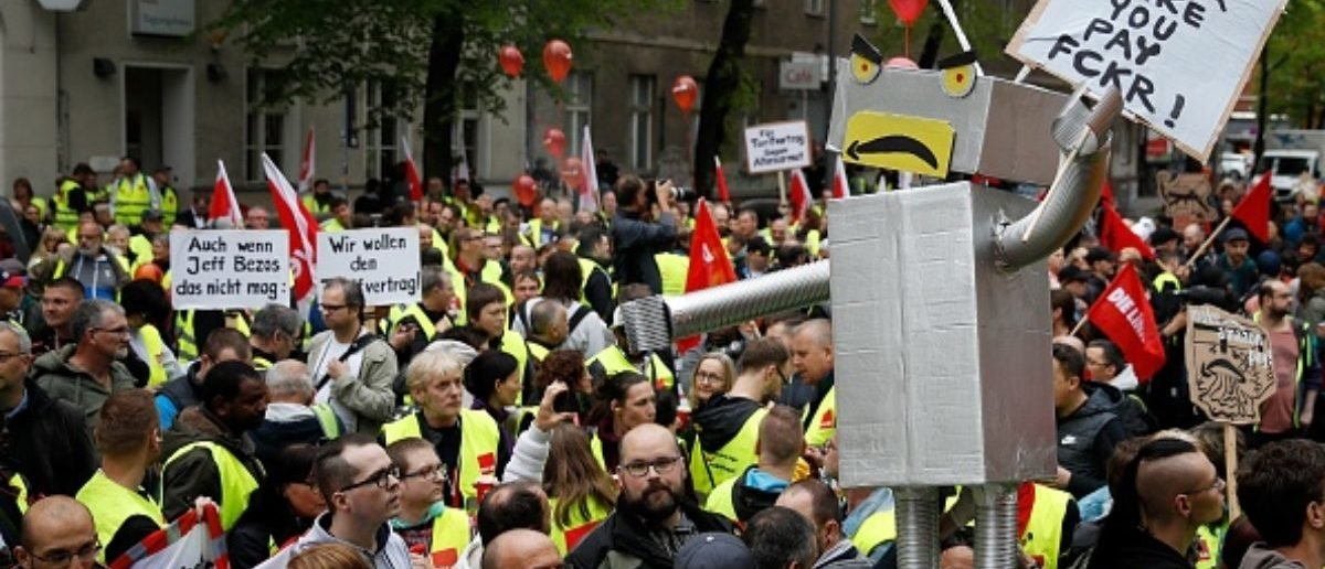 Amazon employees protest against Amazon CEO Jeff Bezos before he arrives at the headquarters of publisher Axel-Springer where he will receive the Axel Springer Award 2018 on April 24, 2018 in Berlin. (Photo by Odd ANDERSEN / AFP) (Photo credit should read ODD ANDERSEN/AFP/Getty Images)