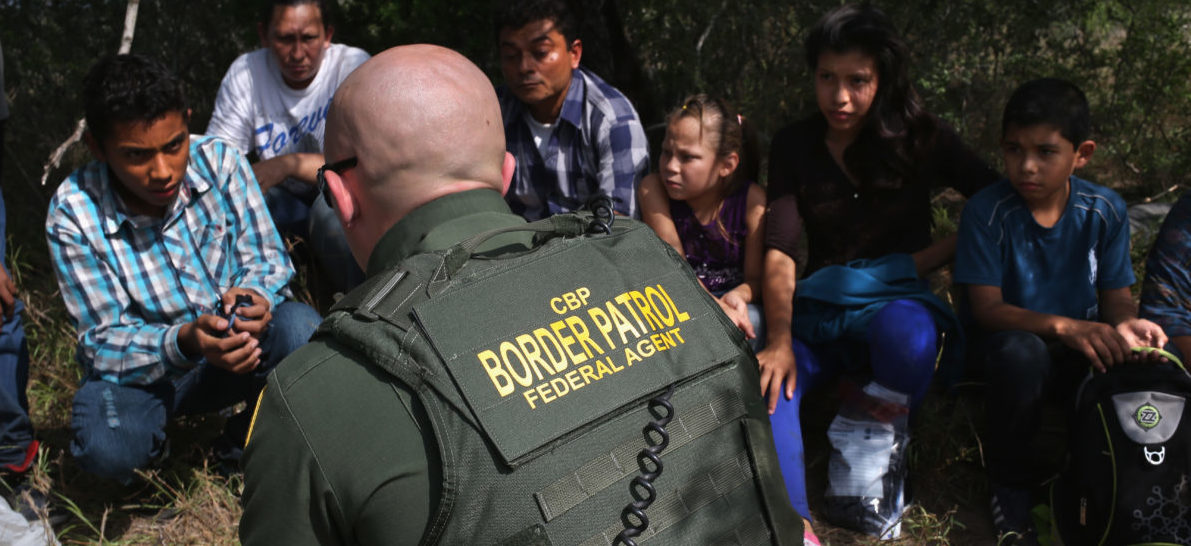 ROMA, TX - APRIL 14:  A Border Patrol agent speaks with Central American immigrant families who crossed into the United States seeking asylum on April 14, 2016 in Roma, Texas. Border security and immigration, both legal and otherwise, continue to be contentious national issues in the 2016 Presidential campaign.  (Photo by John Moore/Getty Images)