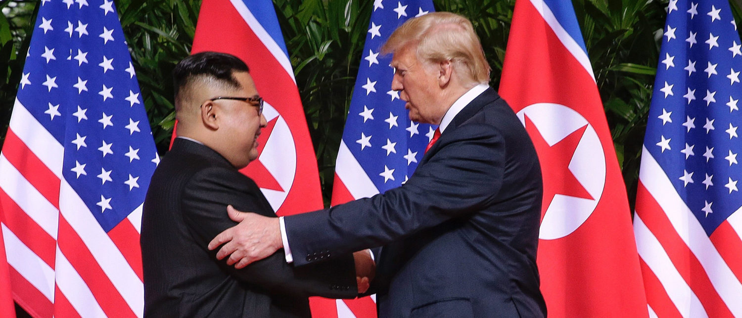 SINGAPORE - JUNE 12: In this handout photo, North Korean leader Kim Jong-un (L) shakes hands with U.S. President Donald Trump during their historic U.S.-DPRK summit at the Capella Hotel on Sentosa island on June 12, 2018 in Singapore. U.S. President Trump and North Korean leader Kim Jong-un held the historic meeting between leaders of both countries on Tuesday morning in Singapore, carrying hopes to end decades of hostility and the threat of North Korea's nuclear program. (Photo by Handout/Getty Images)