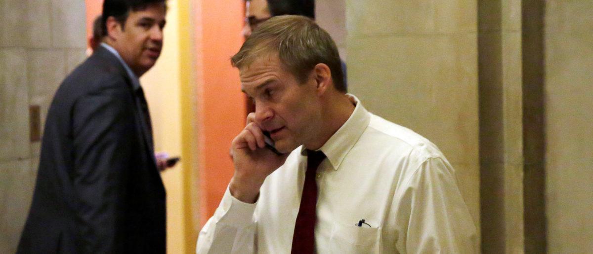 Representative Jim Jordan speaks on a phone outside the Speaker's office on Capitol Hill in Washington, U.S., March 23, 2017. REUTERS/Yuri Gripas