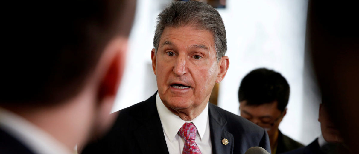"Senator Joe Manchin (D-WV) speaks to the media as he arrives for a Senate Intelligence Committee hearing evaluating the Intelligence Community Assessment on ""Russian Activities and Intentions in Recent US Elections"" on Capitol Hill in Washington, U.S., May 16, 2018. REUTERS/Joshua Roberts."