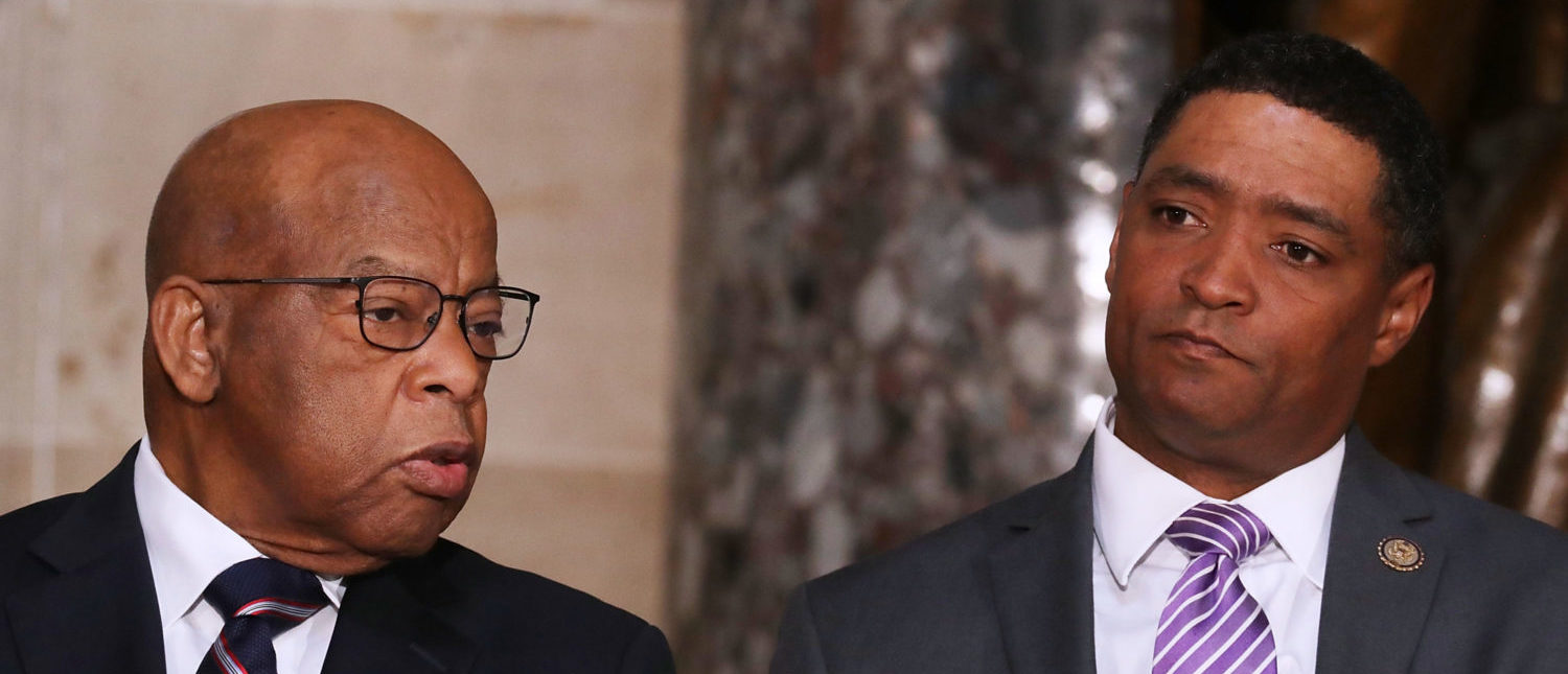 WASHINGTON, DC - APRIL 12: Rep. John Lewis (D-GA) (L) and Congressional Black Caucus Chairman Rep. Cedric Richmond (D-LA) participate in a ceremony to mark the 50th anniversary of the assassination of Dr. Martin Luther King Jr. in Statuary Hall at the U.S. Capitol April 12, 2018 in Washington, DC. The House of Representatives memorialized the day that Nobel Peace Prize and American civil rights leader King was killed while supporting a sanitation workers strike in Memphis, Tennessee. (Photo by Chip Somodevilla/Getty Images)
