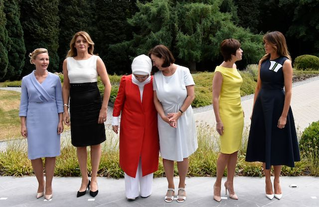NATO Leaders spouses (L/R): Slovenian Prime Minister's wife Mojca Stropnik , Bulgarian President's wife Desislava Radeva, Turkish President's wife Emine Erdogan, NATO Secretary General's wife Ingrid Schulerud, Belgian Prime Minister's partner Amelie Derbaudrenghien and US First Lady Melania Trump pose during a visit to the The Queen Elisabeth Music Chapel in Waterloo on July 11, 2018, on the sidelines of the first day of the North Atlantic Treaty Organisation (NATO) summit in Belgium. (Photo credit: RICCARDO PAREGGIANI/AFP/Getty Images)
