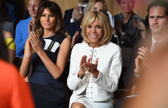 French President's wife Brigitte Macron (R) and US First Lady Melania Trump applaud a musical performance during a visit of the NATO Leaders spouses to the The Queen Elisabeth Music Chapel in Waterloo on July 11, 2018, on the sidelines of the first day of the North Atlantic Treaty Organisation (NATO) summit in Belgium. (Photo credit: RICCARDO PAREGGIANI/AFP/Getty Images)