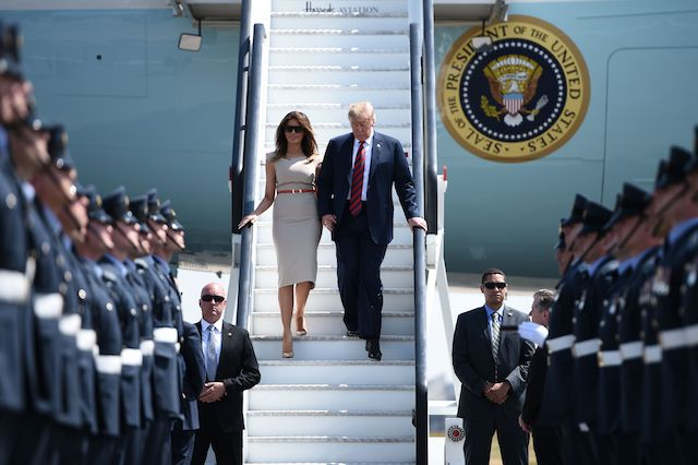US President Donald Trump (R) and US First Lady Melania Trump (L) disembark Air Force One at Stansted Airport, north of London on July 12, 2018, as he begins his first visit to the UK as US president. - The four-day trip, which will include talks with Prime Minister Theresa May, tea with Queen Elizabeth II and a private weekend in Scotland, is set to be greeted by a leftist-organised mass protest in London on Friday.(Photo credit: BRENDAN SMIALOWSKI/AFP/Getty Images)