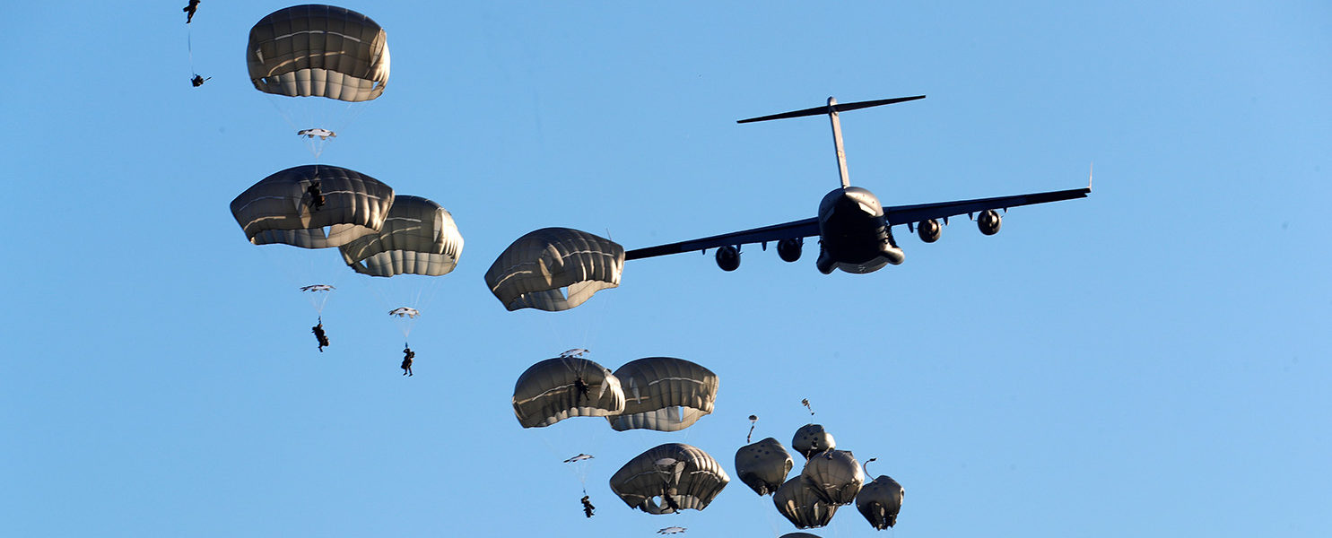 U.S. Army paratroopers leave C-17 aircraft to land during NATO exercise Swift Response 2018 on Adazi military ground, Latvia June 9, 2018. REUTERS/Ints Kalnins