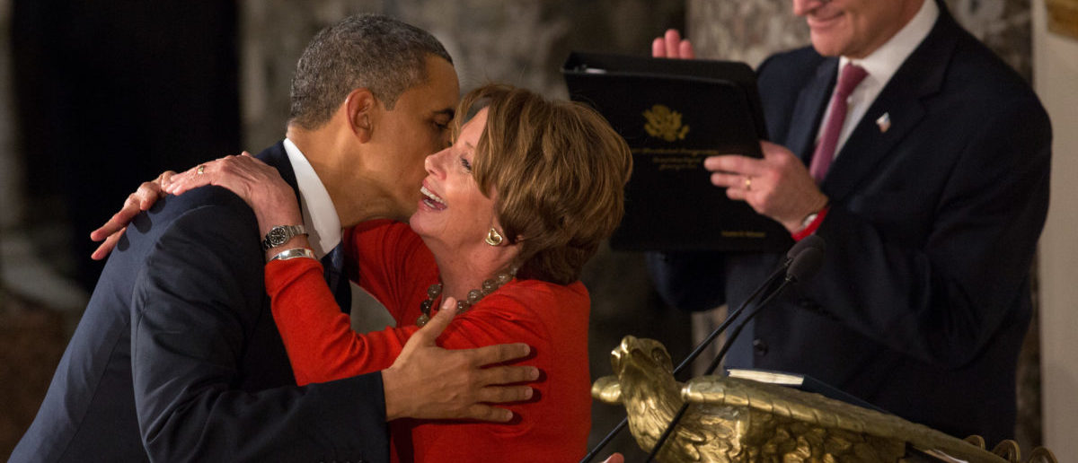 WASHINGTON, DC - JANUARY 21: U.S. President Barack Obama embraces Speaker of the House Nancy Pelosi at the Inaugural Luncheon in Statuary Hall on inauguration day at the U.S. Capitol building January 21, 2013 in Washington D.C. President Obama was ceremonially sworn in for his second term today. (Photo by Allison Shelley/Getty Images)