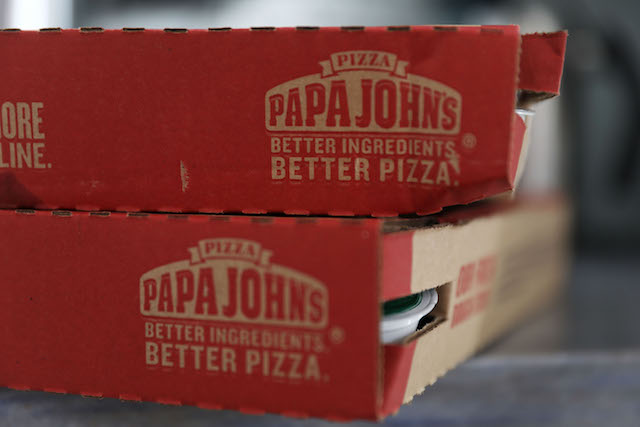 In this photo illustration, a Papa John's pizza box is seen on July 11, 2018 in Miami, Florida. The founder of Papa John's pizza, John Schnatter, apologized Wednesday for using the N-word on a conference call in May. (Photo illustration by Joe Raedle/Getty Images)