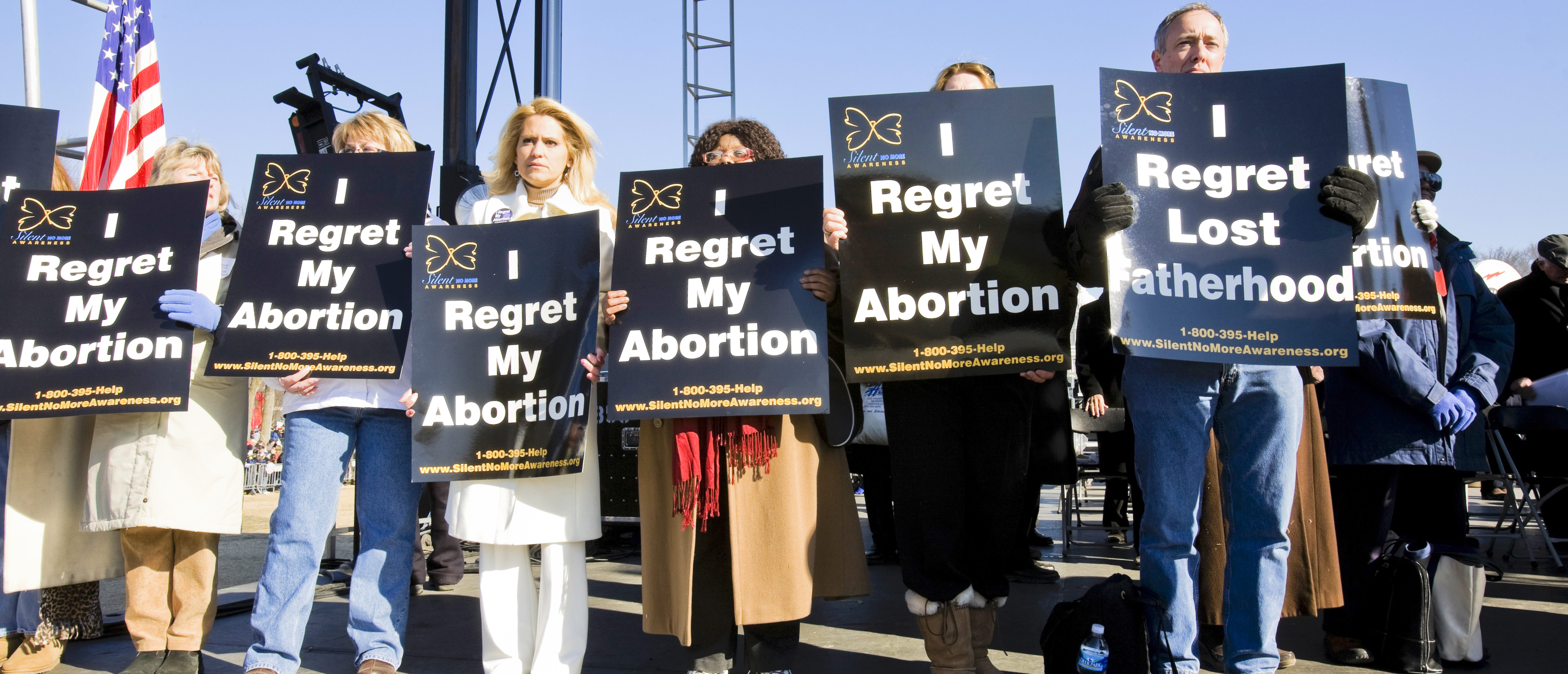 Pro-lifers holding sign (Shutterstock/ B Christopher)