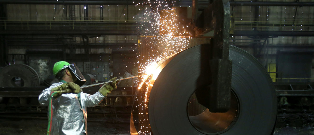 A worker cuts a piece from a steel coil at the Novolipetsk Steel PAO steel mill in Farrell, Pennsylvania, U.S., March 9, 2018. REUTERS/Aaron Josefczyk