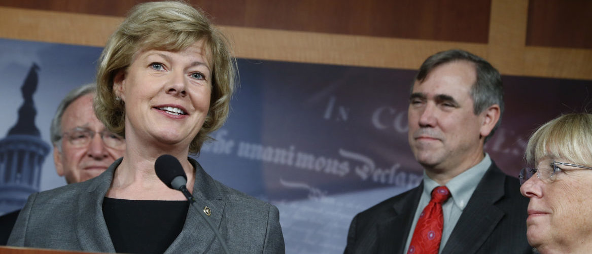 U.S. Senator Tammy Baldwin (From 2nd L-R), Senator Jeff Merkley and Senator Patty Murray appear at a news conference to celebrate overcoming the last procedural hurdle to bring a vote in the U.S. Senate on legislation to ban workplace discrimination against gay individuals at the U.S. Capitol in Washington, November 7, 2013. Also pictured is Senator Tom Harkin (L). REUTERS/Jonathan Ernst