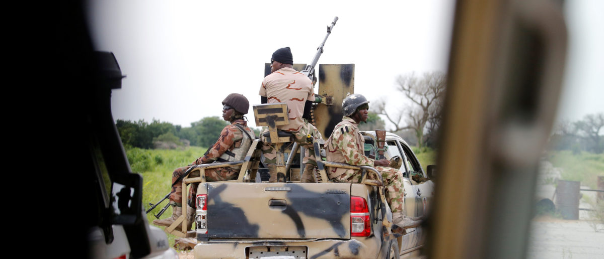 A Nigerian army convoy vehicle drives ahead with an anti-aircraft gun, on its way to Bama, Borno State, Nigeria August 31, 2016. Ali Goni was kidnapped in Bama five years ago. Picture taken from inside a vehicle. REUTERS/Afolabi Sotunde