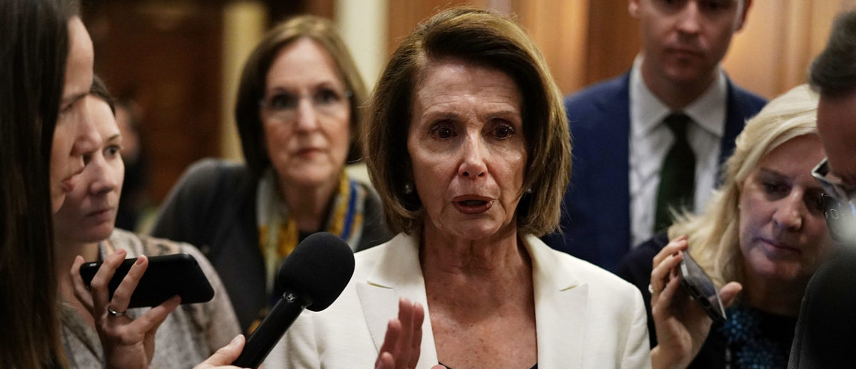 WASHINGTON, DC - FEBRUARY 07: U.S. House Minority Leader Rep. Nancy Pelosi (D-CA) (C) speaks to members of the media after her 8-hour long speech on immigration at the Capitol February 7, 2018 in Washington, DC. Pelosi exercised her power as minority leader and launched a filibuster-like floor speech on Dreamers and urged Republicans to take action to solve their status before the March 5th deadline President Trump has set for the Deferred Action for Childhood Arrivals policy. (Photo by Alex Wong/Getty Images)